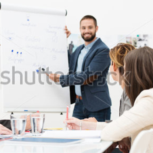 NEU_stock-photo-businessman-giving-a-presentation-to-his-colleagues-at-work-standing-in-front-of-a-flipchart-with-155222177