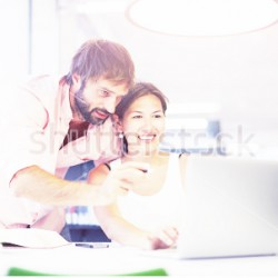 stock-photo-business-team-having-fun-while-working-on-a-laptop-business-meeting-of-two-professionals-in-the-211225513